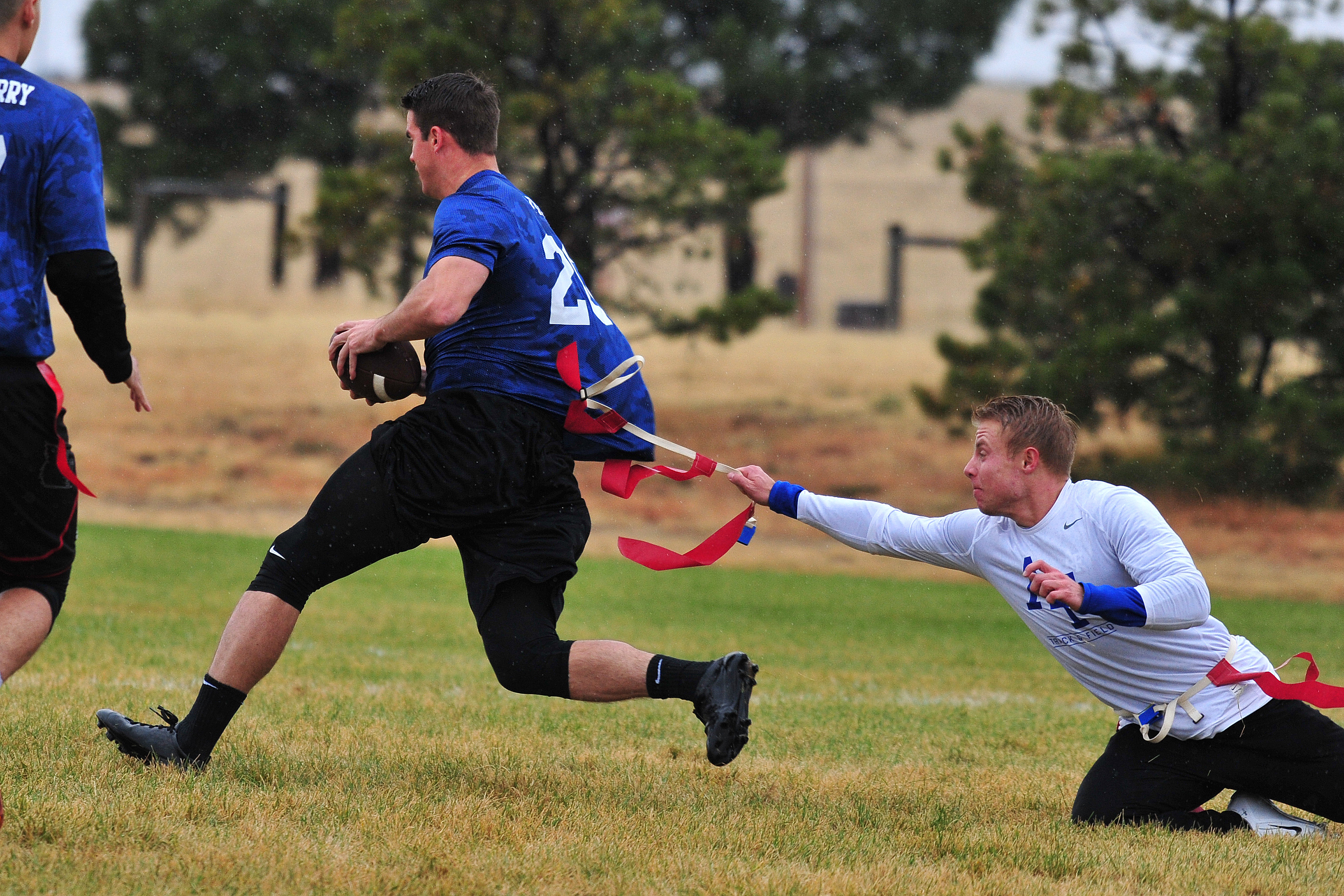 SCHRIEVER AIR FORCE BASE, Colo. -- The 50th Operations Support Squadron defeated the 4th Space Operations Squadron to claim the Wing Flag Football championship at Schriever AFB, Colorado 24 October, 2018. (U.S. Air Force Photo/Dennis Rogers)